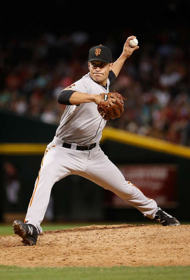 PHOENIX, AZ - MAY 15:  Relief pitcher Javier Lopez #49 of the San Francisco Giants pitches against the Arizona Diamondbacks during the seventh inning of the MLB game at Chase Field on May 15, 2016 in Phoenix, Arizona.  (Photo by Christian Petersen/Getty Images) Photo: Christian Petersen, Getty Images