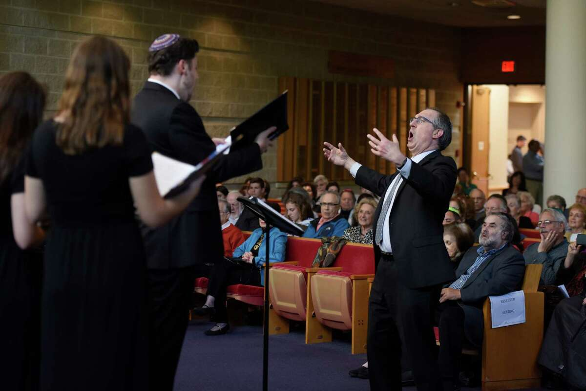 Cantor Gerald Cohen conducts the Temple Sholom teen choir during a performance at the Centennial Concert at Temple Sholom in Greenwich, Conn. Sunday, May 15, 2016. The concert explored the changes in Jewish music through time, spanning from early origins to contemporary and Jewish broadway and Yiddish theater. The performance featured vocals from several accomplished cantors and the Temple Sholom teen and youth choirs.