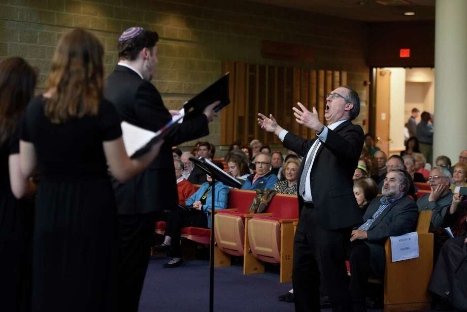 Cantor Gerald Cohen conducts the Temple Sholom teen choir during a performance at the Centennial Concert at Temple Sholom in Greenwich, Conn. Sunday, May 15, 2016. The concert explored the changes in Jewish music through time, spanning from early origins to contemporary and Jewish broadway and Yiddish theater. The performance featured vocals from several accomplished cantors and the Temple Sholom teen and youth choirs. Photo: Tyler Sizemore / Hearst Connecticut Media / Greenwich Time