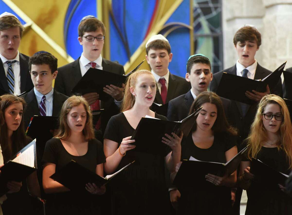 Hannah Bein, center, sings with other members of the teen choir during the Centennial Concert at Temple Sholom in Greenwich, Conn. Sunday, May 15, 2016. The concert explored the changes in Jewish music through time, spanning from early origins to contemporary and Jewish broadway and Yiddish theater. The performance featured vocals from several accomplished cantors and the Temple Sholom teen and youth choirs.