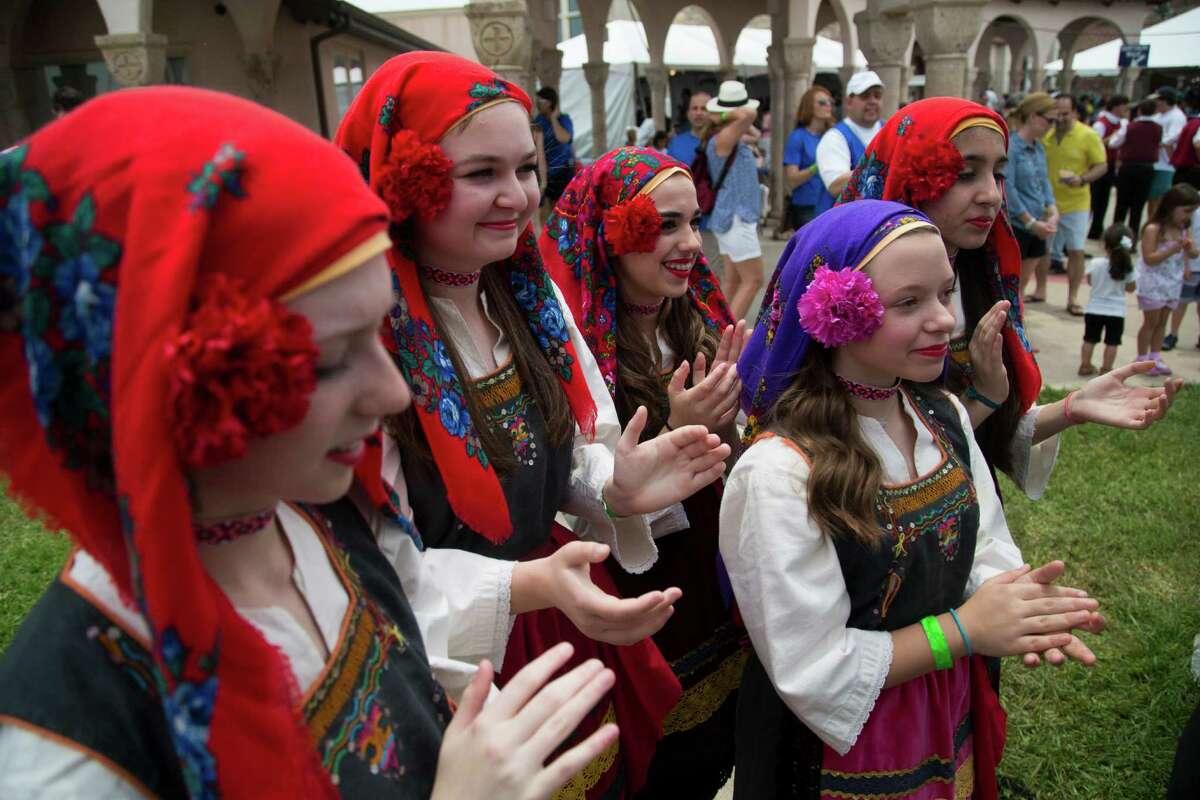 (left to right) Zoe Bourdoumis, 15, Sylvana Caromano, 14, Nicoletta Varcados, 14, Maria Vastakis, 14, and Nina Klonis, 14, al members of The Kefi Dancers wait for their turn to perform at the 2016 Houston Greek Fest, Sunday, May 15, 2016, in Houston.