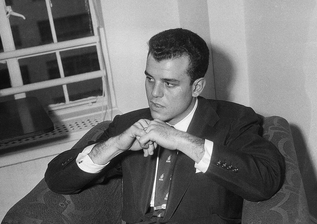 FILE - In this Oct. 26, 1953, file photo, Julius La Rosa, who was fired from the Arthur Godfrey shows, listens to a question during a news conference in Ed Sullivan's apartment in New York. La Rosa, a pop singer known for hits including