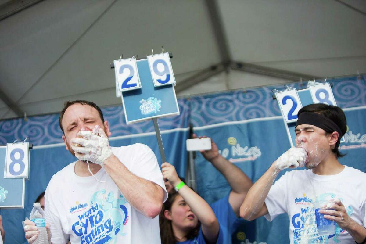 Joey Chestnut, left, and Matt Stonie eat the last gyros during the World Gyro Eating Championship, Sunday, May 15, 2016, in Houston. In ten minutes, Chestnut ate 30 gyros and Stonie ate 28.5 gyros during at the 2016 Houston Greek Fest.