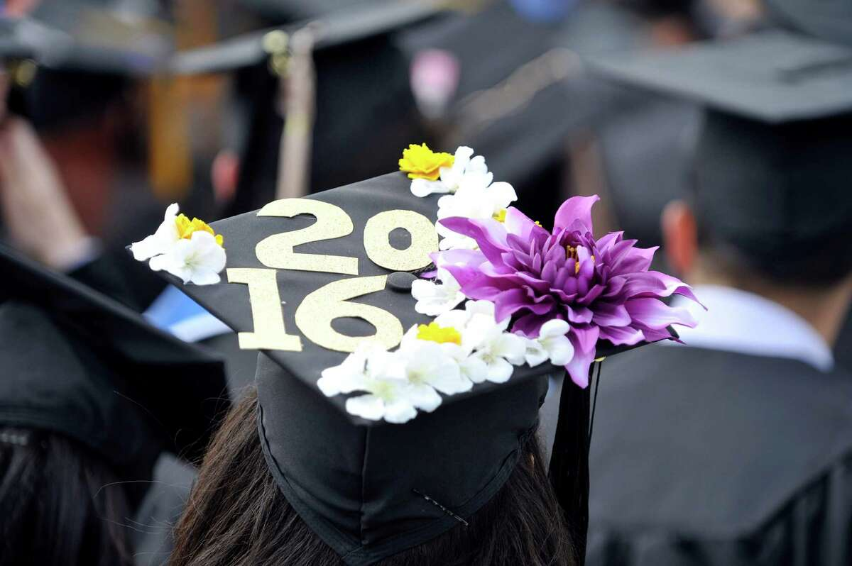 Graduates sit and listen to guest speakers at the University at Albany undergraduate Commencement Ceremony on Sunday, May 15, 2016, in Albany, N.Y. The college graduated approximately 2,197 students on Sunday. (Paul Buckowski / Times Union)