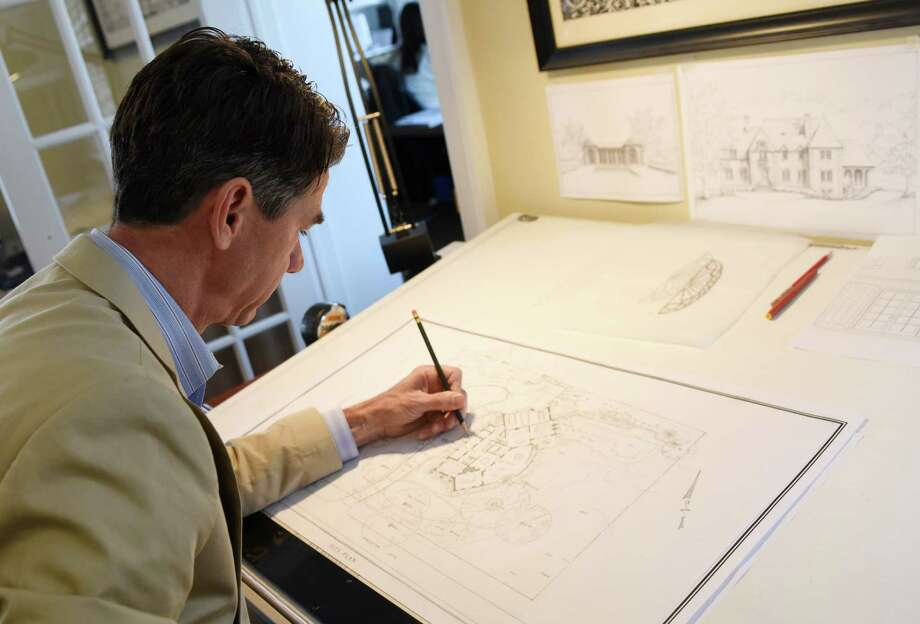 Douglas VanderHorn edits an architectural sketch at his desk in the VanderHorn Architects office in Greenwich, Conn. Tuesday, May 10, 2016. VanderHorn specializes in classically-styled residential design in Connecticut and New York. Photo: Tyler Sizemore / Hearst Connecticut Media / Greenwich Time