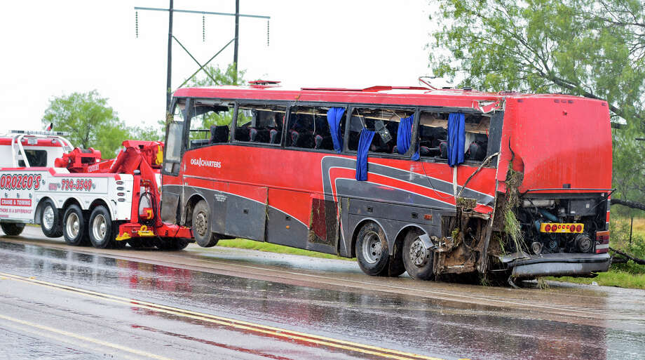 A damaged OGA Charters bus is hauled away after a fatal rollover on Saturday, May 14, 2016, south of the Dimmit-Webb County line on U.S. 83 North in Texas. (Laredo Texas, Nuevo Laredo Mexico out, Mandatory credit Danny Zaragoza | Laredo Morning Times.) Photo: Danny Zaragoza, MBO / Associated Press / Laredo Morning Times
