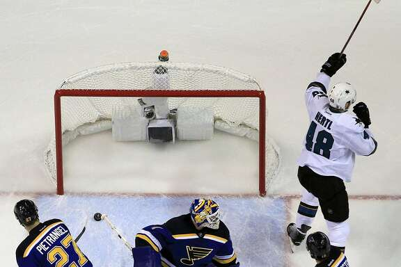 San Jose Sharks center Joe Pavelski (8) celebrates after scoring a goal against St. Louis Blues goalie Brian Elliott (1) during the first period in Game 1 of the NHL hockey Stanley Cup Western Conference finals, Sunday, May 15, 2016, in St. Louis. (AP Photo/Jeff Roberson)