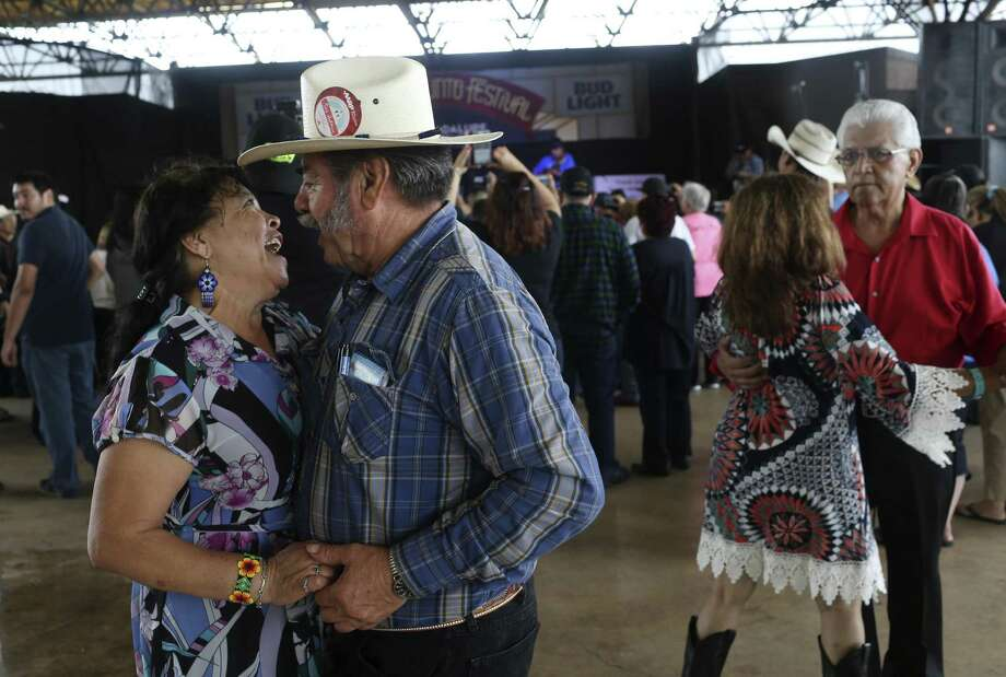 Fidel and Ofelia Flores, of Freemont, California, dance to the music of Bernardo y Sus Compadres during the Tejano Conjunto Festival en San Antonio in 2016. The nation's longest-running conjunto festival returns to Rosedale Park this weekend. Photo: JERRY LARA /San Antonio Express-News / © 2016 San Antonio Express-News