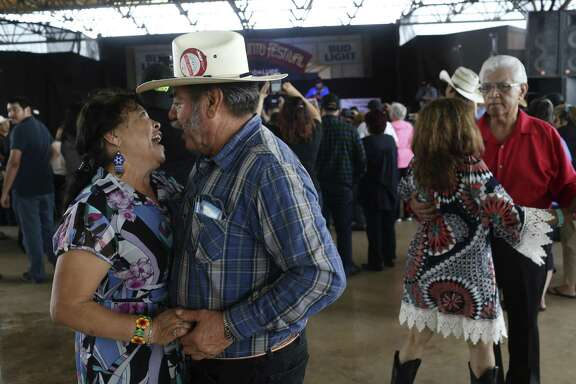 Fidel and Ofelia Flores, of Freemont, California, dance to the music of Bernardo y Sus Compadres during the Tejano Conjunto Festival en San Antonio in 2016. The nation's longest-running conjunto festival returns to Rosedale Park this weekend.