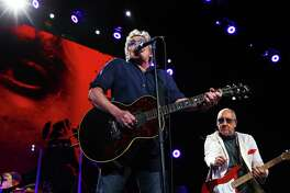 Roger Daltrey and Pete Townshend play as The Who performs at Key Arena, Sunday, May 15, 2016.