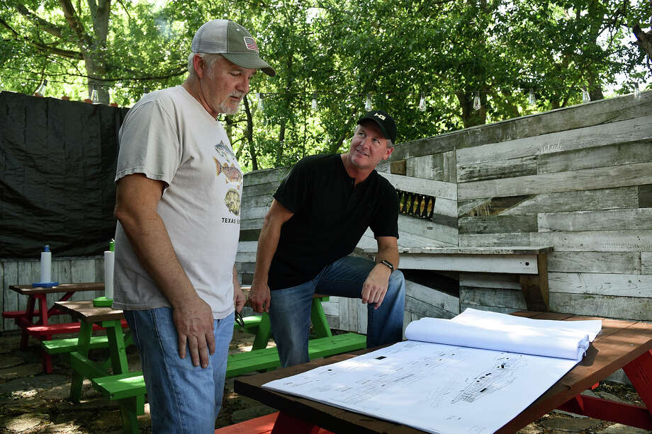 Scott Moore, left, the founder and owner of Tejas Chocolate Craftory  in downtown Tomball, visits on his patio dining area with Bryan Hutson, a local attorney and developer who is working to transform Old Town Tomball. (Photo by Jerry Baker/Freelance) Photo: Jerry Baker, Freelance