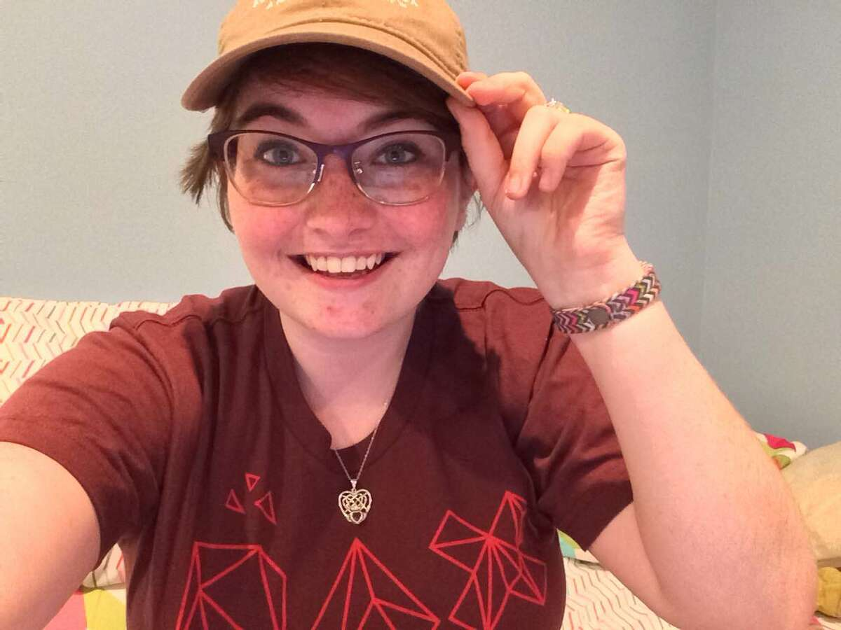 Aimee Toms, 22, of Naugatuck, shows off the baseball cap she was wearing in the bathroom of the Danbury Walmart when another woman mistook her for a transgender person and told her she shouldn't be there.