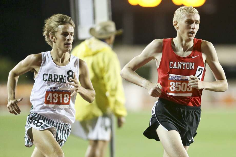 New Braunfels Canyon's Sam Worley (right) leads Southlake Carroll's Reed Brown as they start the final lap of the 6A boys 1,600-meter run during the third and final day of the UIL State Track and Field Championships at Myers Stadium in Austin on May 14, 2016. Photo: Marvin Pfeiffer /San Antonio Express-News / Express-News 2016
