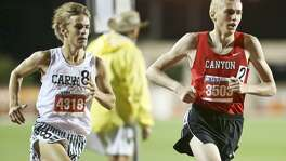 New Braunfels Canyon's Sam Worley (right) leads Southlake Carroll's Reed Brown as they start the final lap of the 6A boys 1,600-meter run during the third and final day of the UIL State Track and Field Championships at Myers Stadium in Austin on May 14, 2016.