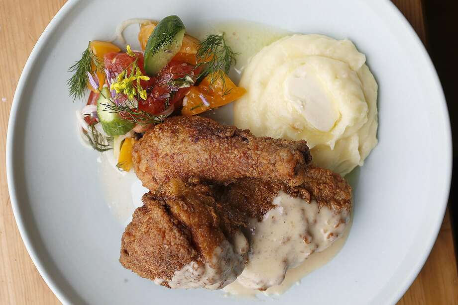 Rich Table owners Evan and Sarah Rich serve Sally Hurricane's Southern Fried Chicken with gravy, tomato salad and mashed potatoes. Photo: Liz Hafalia, The Chronicle