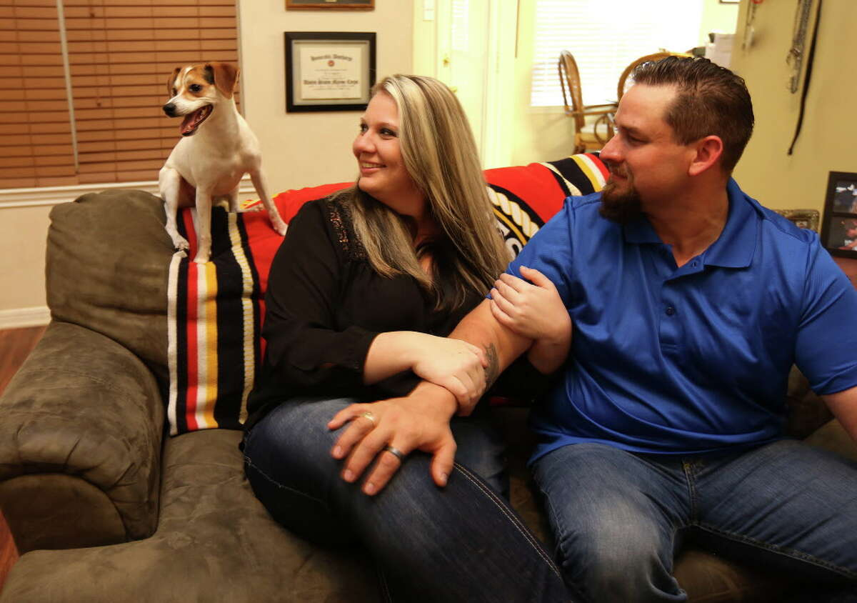 William and Morgan English with Max, one of their three dogs in their Brenham, Texas home on Tuesday, May 3, 2016. The two, who were arrested following a shoot-out in Waco, Texas, are expecting their first child.