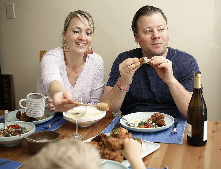 Rich table owners Sarah Rich (left) and her husband Evan Rich (right) at home having chicken with their children in San Francisco, California, on thursday, may 12, 2016.