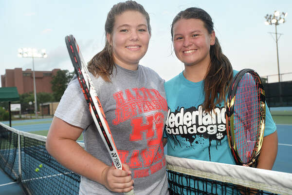 Josie Legato, 16, from Hardin-Jefferson and Jayci Wong, 15, of Nederland will be making the trip to College Station to compete in Monday's state tennis finals. The two have been playing tennis together since they were in elementary school and have been working with the same coach.  Photo taken Thursday, May 12, 2016 Kim Brent/The Enterprise