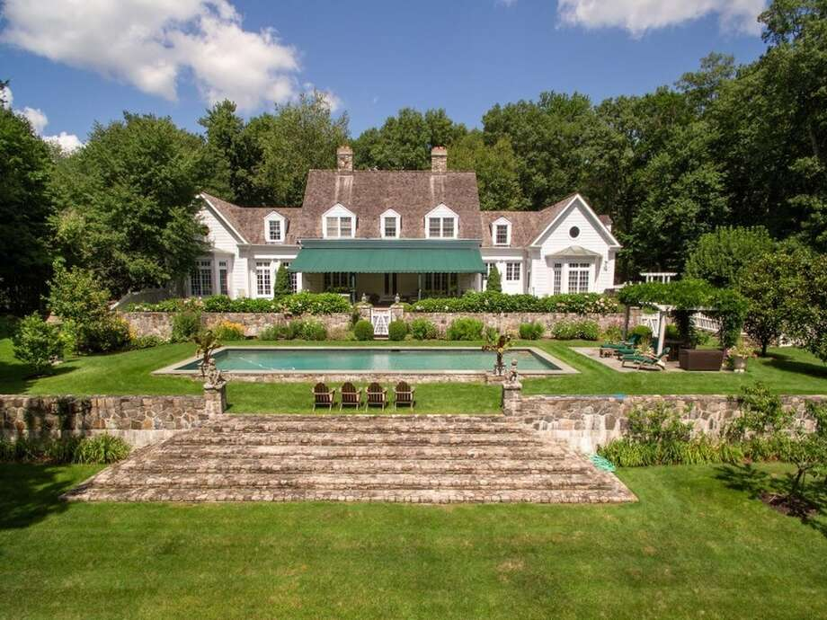 42 Lower Cross Rd, Greenwich, CT 06831 7 beds 6.5 baths 6,123 sqft  Features:Vestiges of the original stone farm structures, living room with French doors opens to terrace overlooking swimming pool,expansive terrace, rugged stone walls, manicured lawns, mature trees View full listing on Zillow Photo: Zillow