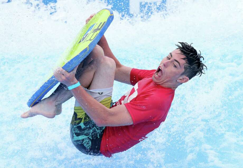 Nathan Boykin of New Braunfels does a drop knee roll on his way to a fourth-place finish in the pro bodyboard division of the FLOW Tour 2016 event at the Hyatt Regency Hill Country Resort. Photo: Edward A. Ornelas /San Antonio Express-News / © 2016 San Antonio Express-News