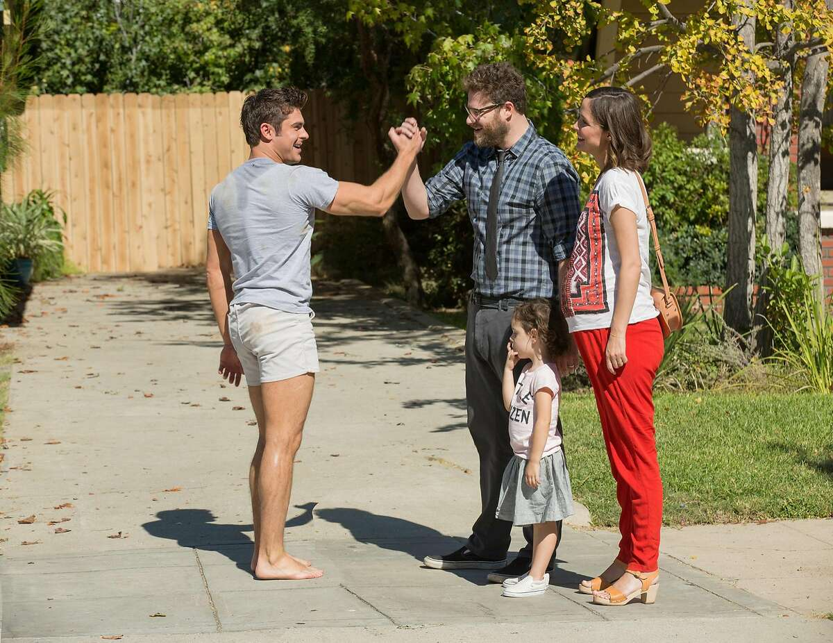 """This image released by Universal Pictures shows, from left, Zac Efron, Seth Rogen and Rose Byrne in a scene from """"Neighbors 2: Sorority Rising,"""" premiering in the U.S. on May 20. (Justin Lubin/Universal Pictures via AP)"""