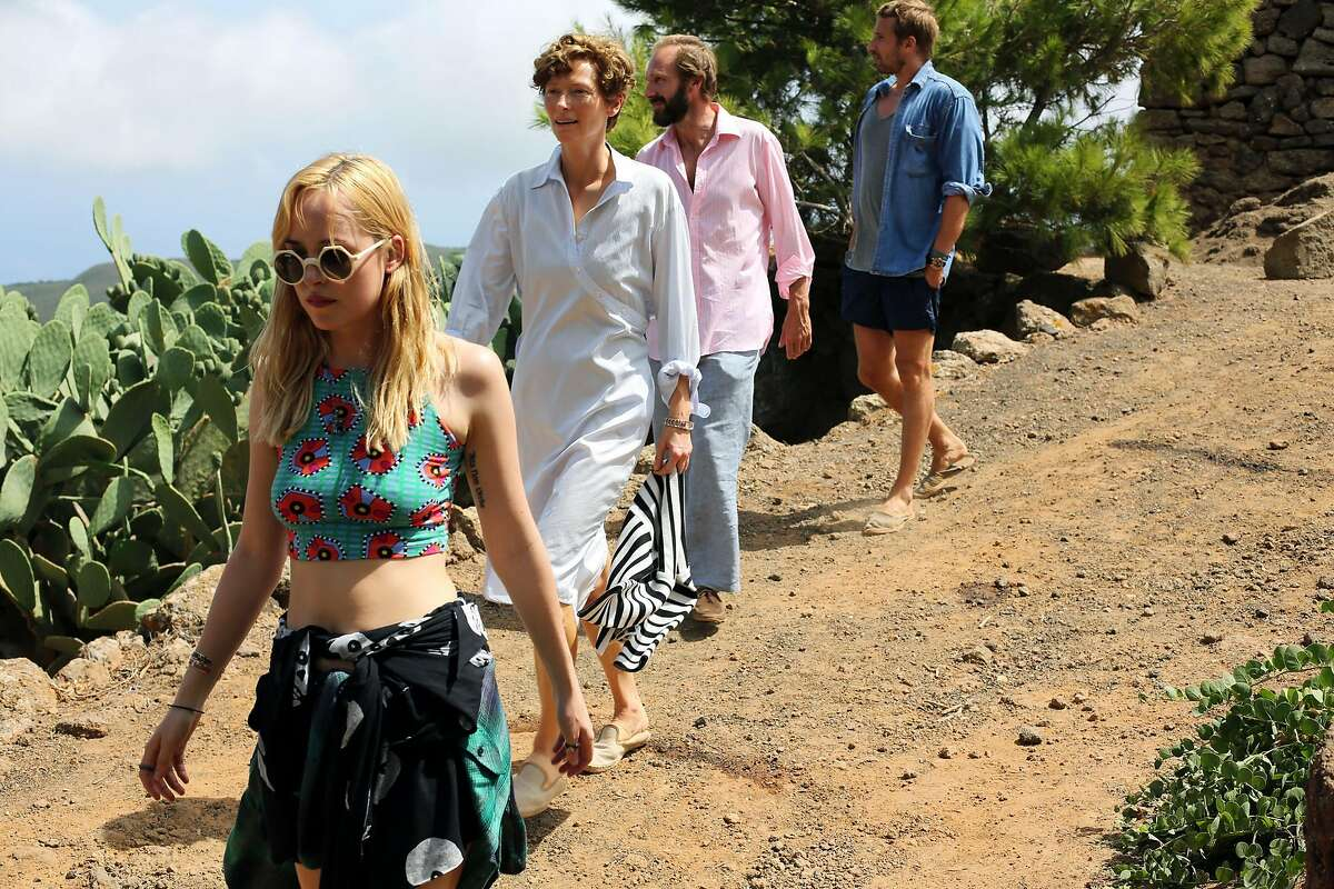 """This image released by Fox Searchlight shows, from left, Dakota Johnson, Tilda Swinton, Ralph Fiennes and Matthias Schoenaerts in a scene from """"A Bigger Splash."""" (Jack English/Fox Searchlight via AP)"""