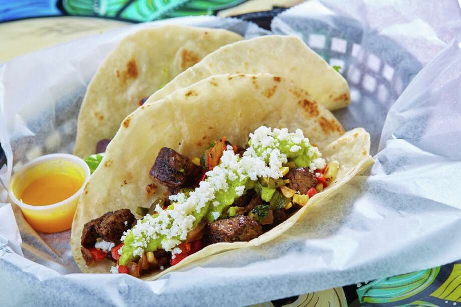 Cowboy Tacos (beef tenderloin with grilled corn, onions, roasted peppers, guacamole and queso fresco) from Tacodeli. Photo: Tacodeli / Tacodeli