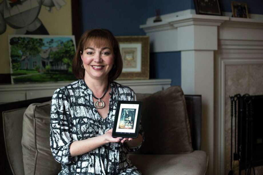 "Lisa Wadler, author of a historical romance novel ""The Draig's Woman,"" at her home in Glencoe, Ill. Wadler started writing to help cope with her husband's illness. Photo: Kristen Norman /Chicaho Tribune / TNS / Chicago Tribune"