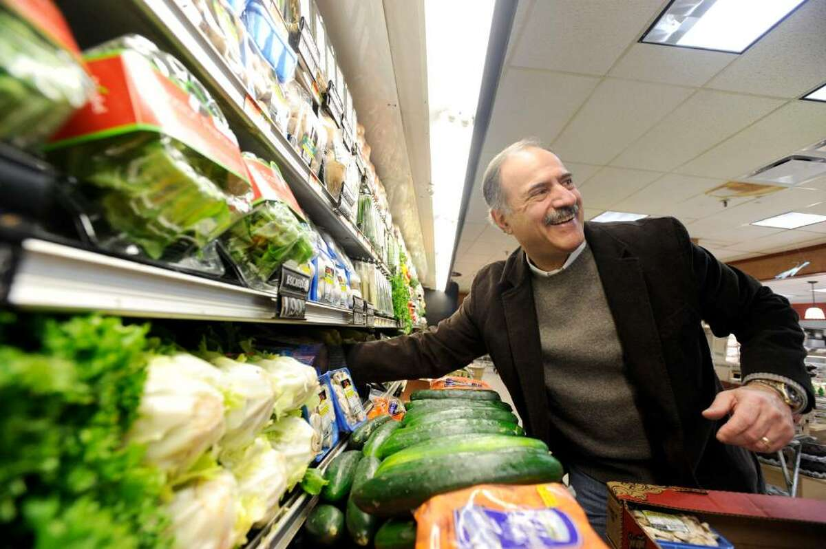 Jerry Porricelli works on the produce layout in the Porricelli's Market in Old Greenwich Saturday morning, Feb. 27, 2010. The store has been the family's flagship since 1950.