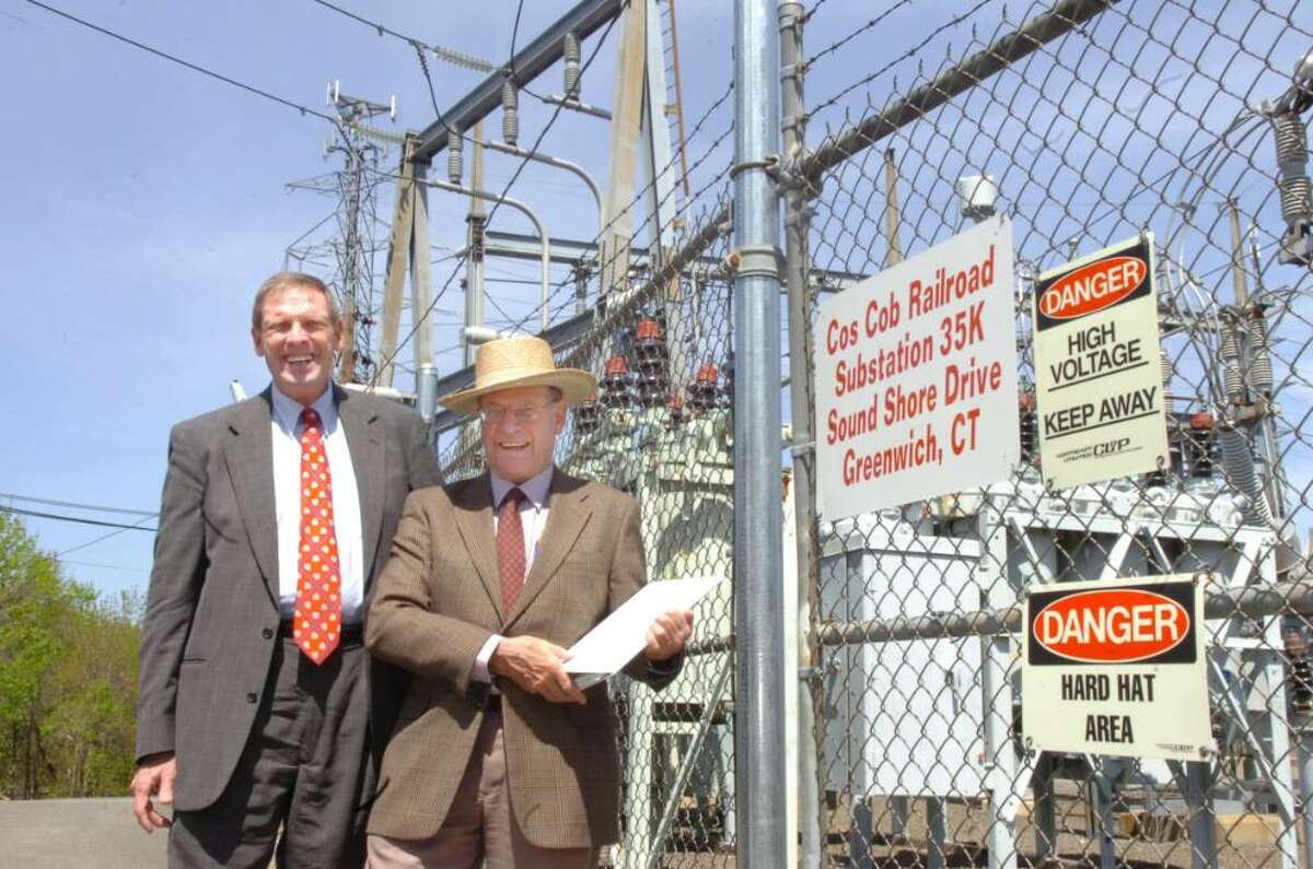 Attorney Dean Montgomery, left, and his brother Barry, look over the site of the former Cos Cob power plant on Thursday, April 15, 2010. Barry Montgomery has launched a lawsuit against the town on its plans to proceed to put a park on the site.