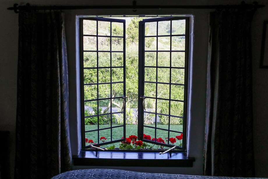 A Tudor-style window at the Pelican Inn near Muir Beach has a view of the ground. Photo: Gabrielle Lurie, Special To The Chronicle