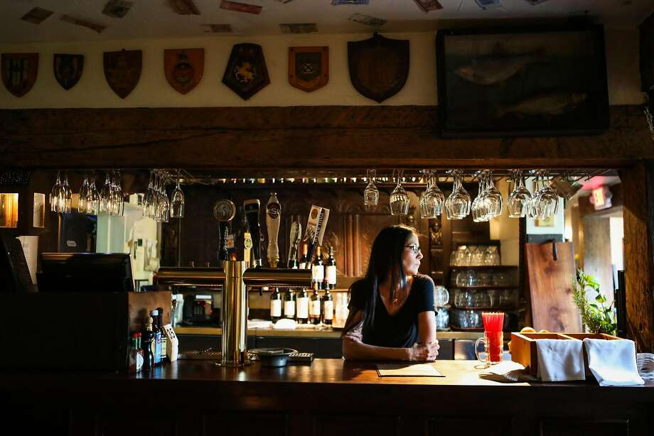 Above, Veronica Archuleta at the English-style pub at the Pelican Inn. Photo: Gabrielle Lurie, Special To The Chronicle