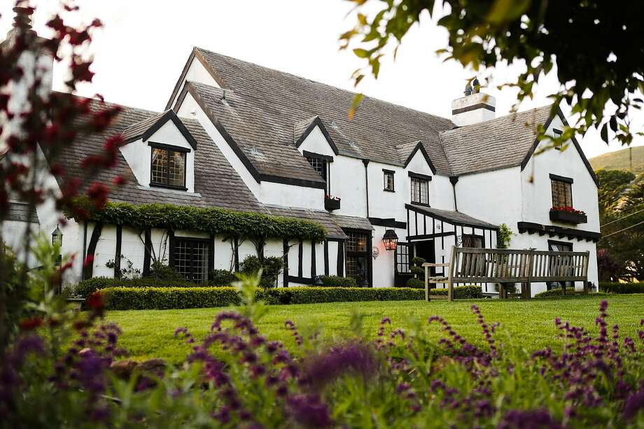 The Pelican Inn offers cozy hotel rooms with canopy beds, a restaurant and pub serving fish and chips and pints of ale, a lawn for picnicking and many, many fireplaces. Photo: Gabrielle Lurie / Special To The Chronicle