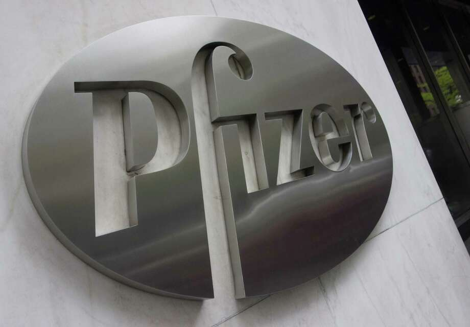 (FILES) This file photo taken on April 26, 2016 shows the Pfizer company logo in front of Pfizers headquarters in New York. US drugs giant Pfizer is buying California biotech company Anacor Pharmaceuticals, a specialist in eczema treatment, in an all-cash $5.2 billion deal, the companies said  ay 16, 2016. Five weeks after scrapping a $160 billion takeover plan with Allergan in the face of a US crackdown on tax-saving mergers, Pfizer announced the Anacor acquisition will add a key anti-inflammatory drug, crisaborole, to its portfolio.  / AFP PHOTO / DON EMMERTDON EMMERT/AFP/Getty Images Photo: DON EMMERT, Staff / AFP/Getty Images / AFP or licensors