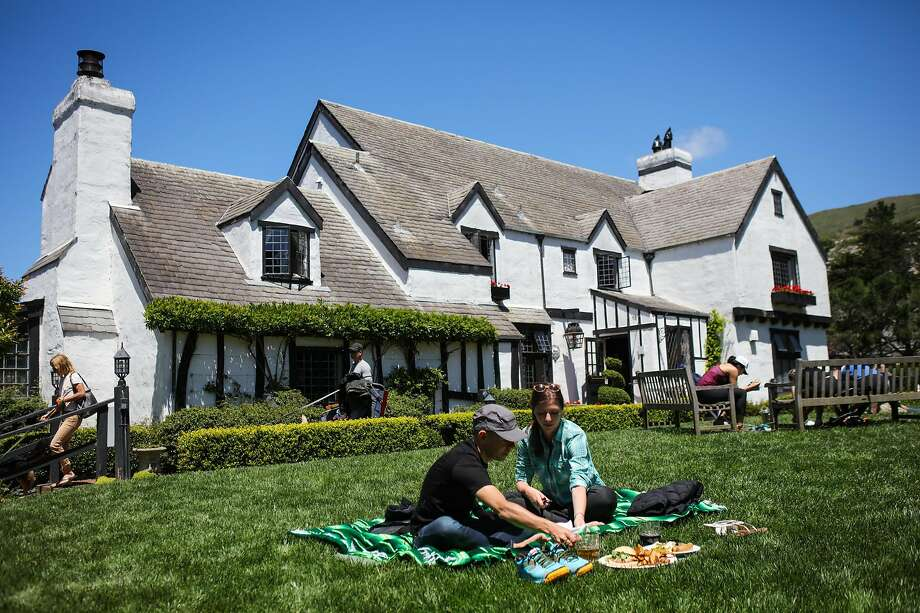 Andres Mino and Allison Schwartz enjoy a picnic outside the Tudor-style Pelican Inn, just a short walk from Muir Beach. Photo: Gabrielle Lurie, Special To The Chronicle