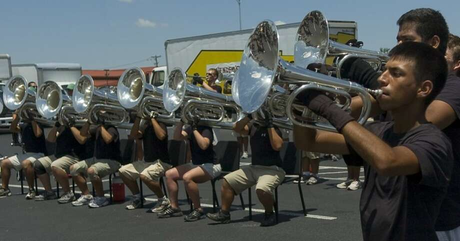 Huriel Hernandez and other members of Genesis perform Monday afternoon outside Best Buy as a preview for todays Thunder in the Desert exhibition at Ratliff Stadium in Odessa. Photo by Tim Fischer/Midland Reporter-Telegram Photo: Tim Fischer