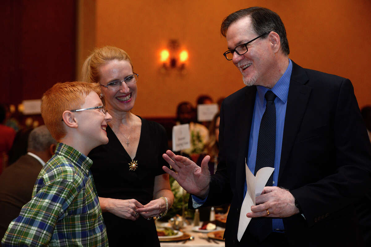 Chase Bridgeman, a fifth-grade student at Guess Elementary, and mother Debbie talk with Superintendent John Frossard during the Beaumont ISD Teacher of the Year Gala on Friday evening. Photo taken Friday 5/13/16 Ryan Pelham/The Enterprise