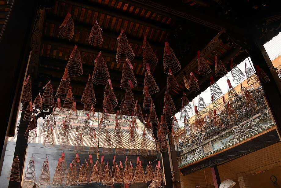 The Phuoc An Hoi Quan Pagoda is known for its hanging incense coils. Photo: Jill K. Robinson, Special To The Chronicle