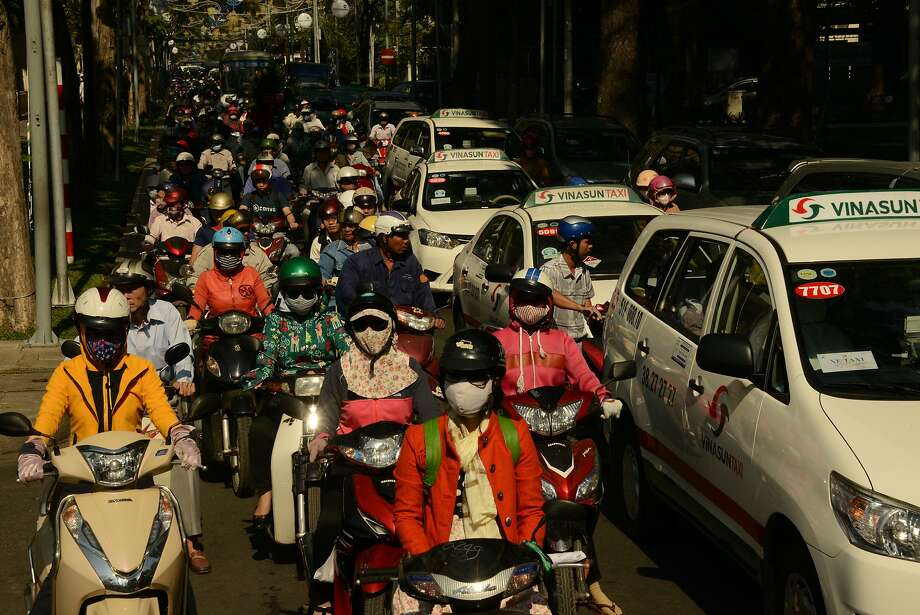 Ho Chi Minh City's chaotic whirl of traffic can be intimidating. A trip on a motorcycle taxi is a great way to get around the city. Photo: Jill K. Robinson, Special To The Chronicle