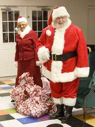Mr And Mrs Claus Find Joy In Sharingchristmas With Kids Of The