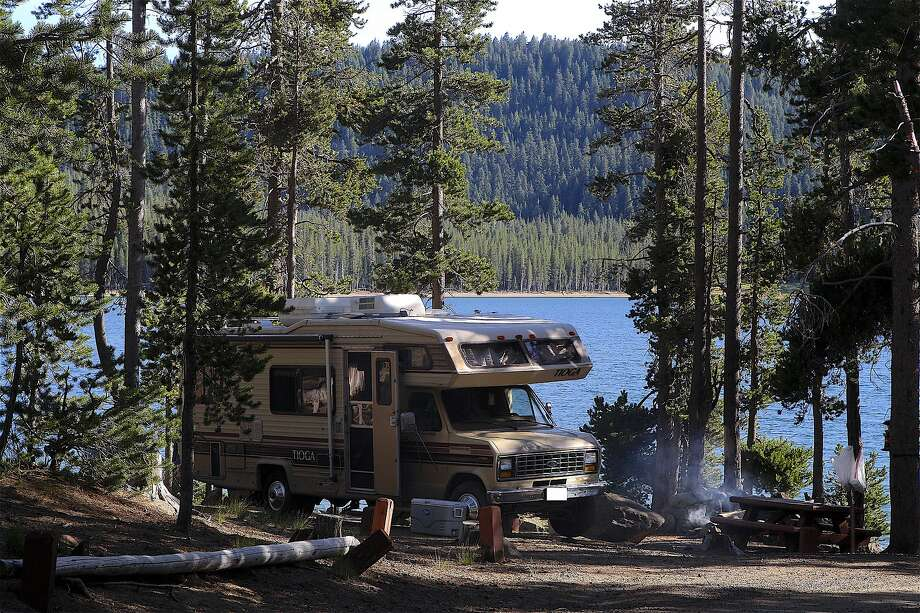 RV sales per year have increased from 1.66 million units in 2009 to 3.72 million in 2015, with continued increased sales this year, with smaller, self-contained units the most popular, like this cab-over van parked along Medicine Lake in Klamath National Forest in Northern California. Photo: Tom Stienstra / The Chronicle