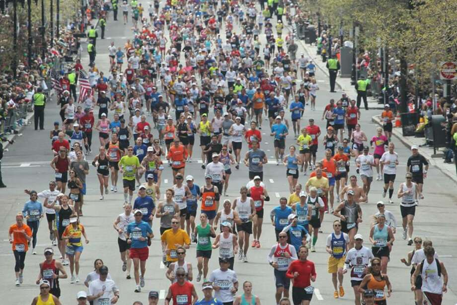 BOSTON - APRIL 19:  Participants run down Boylston Street toward the finish line during the 114th Boston Marathon on April 19, 2010 in Boston, Massachusetts. (Photo by Jim Rogash/Getty Images) Photo: Jim Rogash, Getty Images / 2010 Getty Images