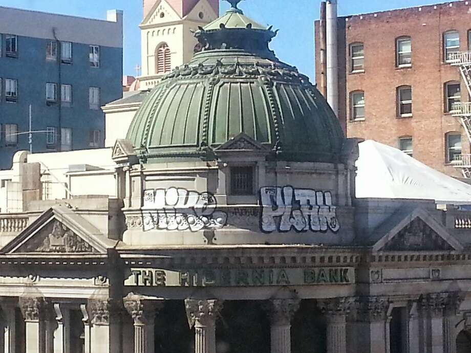 Graffiti defaces the classic Hibernia Bank building. Photo: Courtesy, San Francisco Police Department