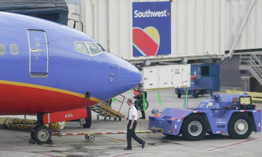 Frustrated Southwest airline pilots, who have begun picketing at airports, want higher pay rates and better retirement contributions. The carrier is seeking to offset rising costs with guarantees of increased productivity. Photo: Mike Stewart /Associated Press / AP