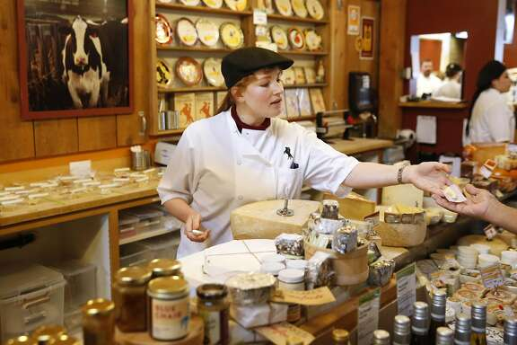 Christy Caye, Assistant Manager and Head of Cheese, gives a sample to a customer in Cowgirl Creamery May 14, 2016 in Point Reyes Station, Calif.