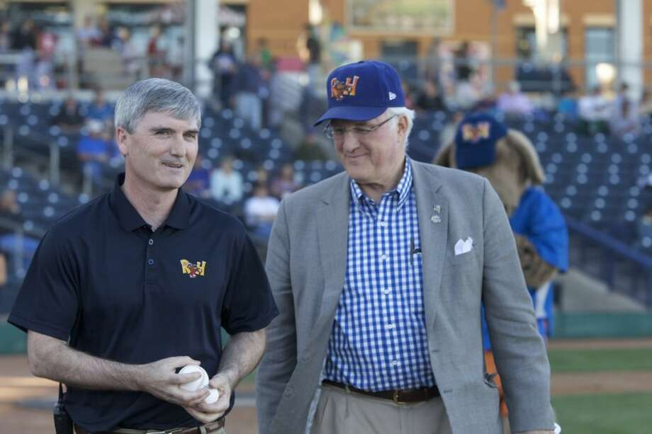Rockhounds owner Miles Prentice, right, walks off the field with club General Manager Monty Hoppel.