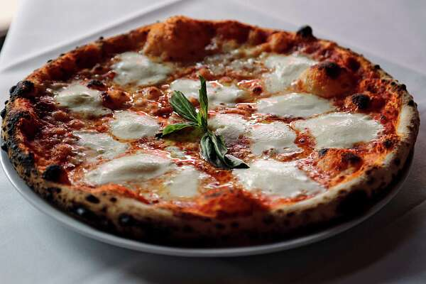 A wood-fired oven Margherita pizza at  Enoteca Rossa Friday, May 13, 2016, in Houston.  ( James Nielsen / Houston Chronicle )