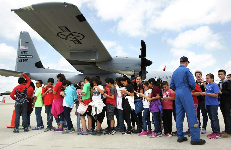 Harlandale fourth- and fifth-graders wait to tour an Air Force Reserve WC-130J Hercules hurricane hunter. Photo: Bob Owen /San Antonio Express-News / ©2016 San Antonio Express-News