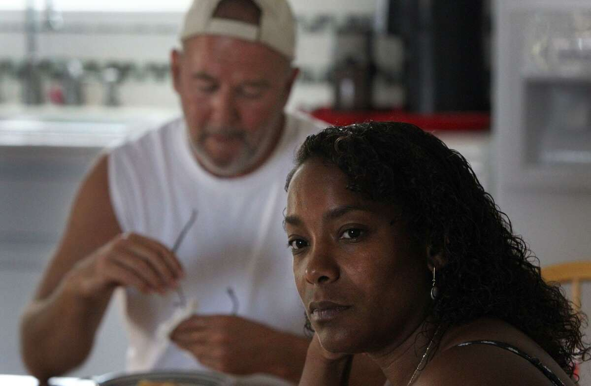 """FILE PHOTO - Monique Rathbun (right) and her husband Mark """"Marty"""" Rathbun (left) of Ingleside, Texas sit in their home Thursday July 7, 2011 while discussing Mark Rathbun's involvement with the Church of Scientology. Mark Rathbun has become a critic of the views held by the organization of the group and says a group claiming to be documentary filmmakers are harassing him. JOHN DAVENPORT/jdavenport@express-news.net"""