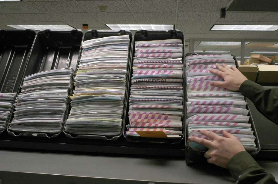File photo of sorted checks at the Federal Reserve Bank Houston Branch. San Antonio-based Payment Data Systems Inc., which provides payment solutions to merchants, banks and others, released its latest quarterly results. Photo: E. Joseph Deering /Houston Chronicle / Houston Chronicle